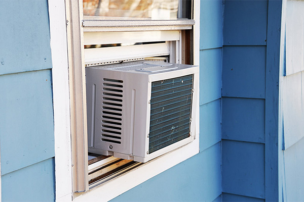 Is running multiple window air conditioners cheaper than running a central unit?